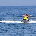 couple on personal watercraft