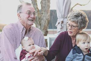 senior couple with grandchildren